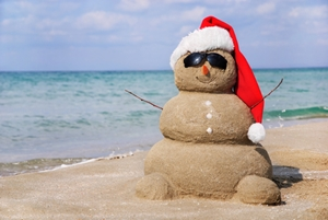 sand man with santa hat